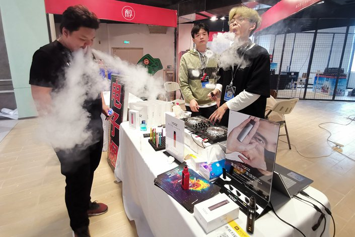 An salesman sells e-cigarettes at a shopping mall in Wuhan, Capital of Central China's Hubei province, on May 2, 2019.