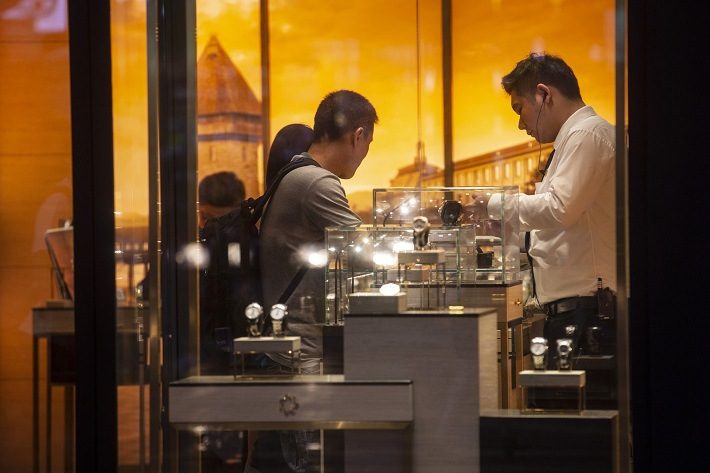Shoppers browse watches on display inside a store in the Causeway Bay district of Hong Kong. Photo: Bloomberg