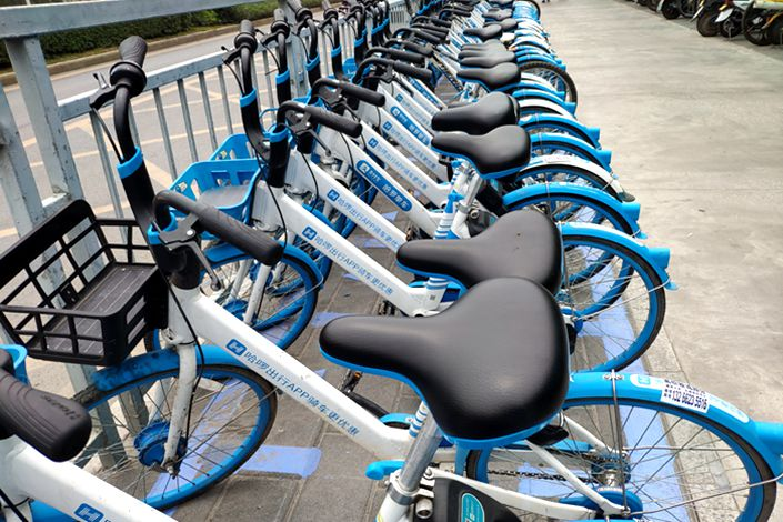 Hellobike shared bicycles are displayed on a street in Shenzhen, Guangdong province, on Sept. 3.