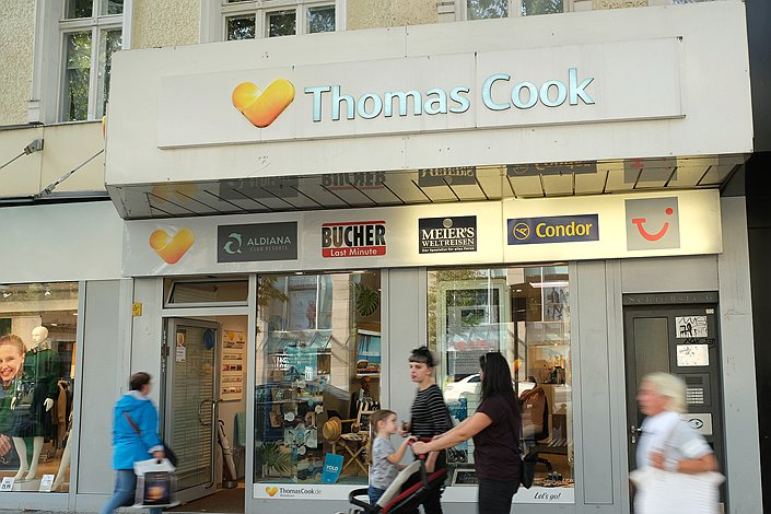 Pedestrians walk past a Thomas Cook travel agency in Berlin on Sept. 23.