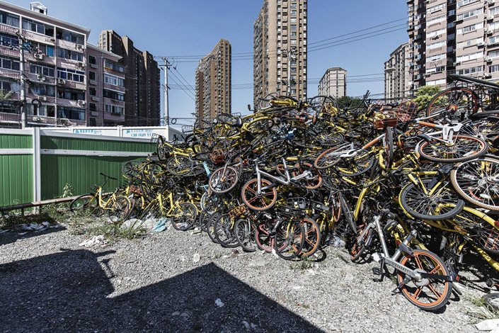 Ride-sharing bicycles sit in a pile in Shanghai on Sept. 12, 2017. Photo: Bloomberg