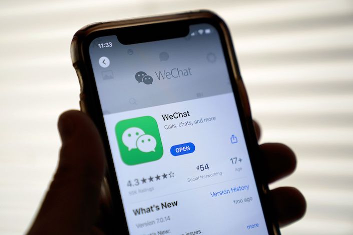 The Tencent Holdings Ltd. WeChat app is displayed in the App Store on a smartphone in an arranged photograph taken in Arlington