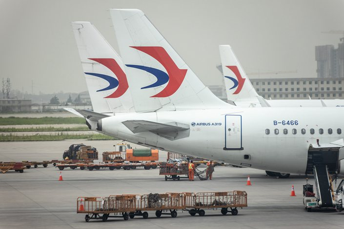 """Under a CAAC policy announced in June, the occurrence of more than five cases appearing on the same flight is supposed to trigger a """"circuit breaker"""" that forces an airline to suspend the route for a week."""