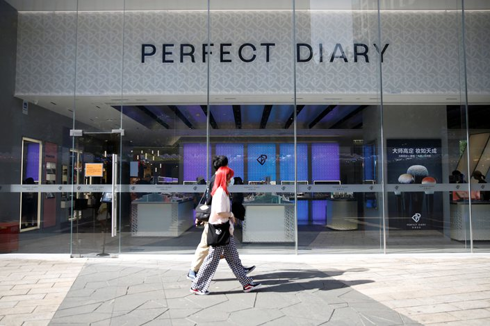 Pedestrians walk past a store of cosmetics brand Perfect Diary in Beijing on Aug. 25.