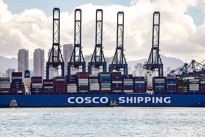 A container ship operated by Cosco sits at the Kwai Tsing Container Terminal in Hong Kong on July 27.