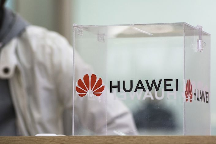 A branded perspex comments box sits on a product display table inside a Huawei Technologies Co. store at Menlyn Park Shopping Center in Pretoria