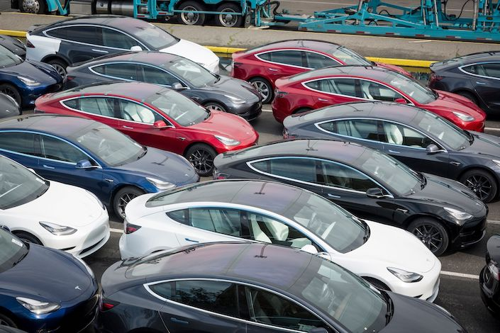 Tesla Inc. vehicles sit in a parking lot before being shipped from the Port of San Francisco in San Francisco
