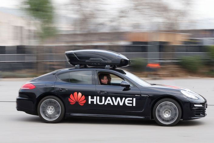 A Porsche Panamera car driven by the Huawei Mate 10 Pro smartphone outside the Camp Nou stadium in Barcelona during the 2018 Mobile World Congress.