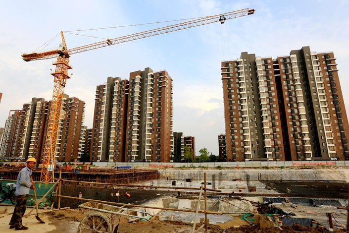 A  residential building  under construction along the Dayun River in Huai'an, East China's Jiangsu province, on Sept. 1.