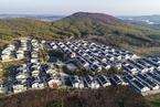 严控房地产化 国家发改委要求淘汰不实小镇