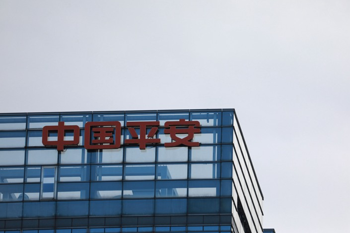 Signage for Ping An Insurance Group Co. is displayed atop a building in Beijing on Thursday, March 14, 2019. Photo: Bloomberg