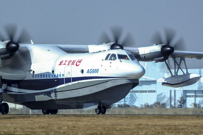 The first large domestically developed amphibious aircraft makes its maiden flight at Zhuhai Jinwan Airport on Dec. 24, 2017.