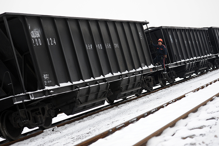 A worker checks a train laden with coal in November 2016 in Huaibei, East China's Anhui province.