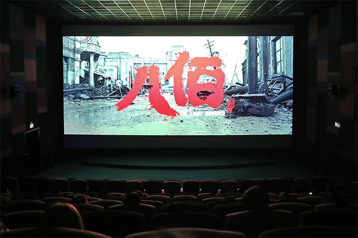 Moviegoers watch the Chinese-made war film