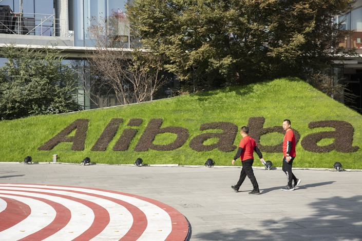 Employees walk through the campus at the Alibaba Group Holding Ltd. headquarters during the annual Nov. 11 Singles' Day online shopping event in Hangzhou on Nov. 11, 2019. Photo: Bloomberg