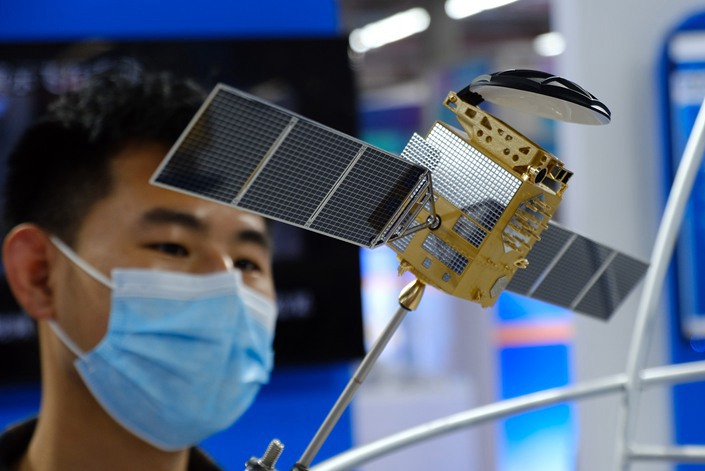 Visitors look at a model BeiDou satellite in Shenyang, capital of Northeast China's Liaoning Province, Sept. 18.