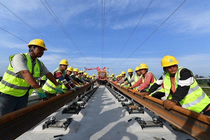 A crew works on a section of the Beijing-Harbin high-speed railway line in Beijing on Sept. 5.