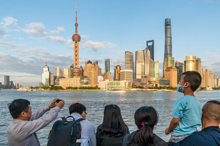 Tourists take photos in Shanghai on Sept. 4.