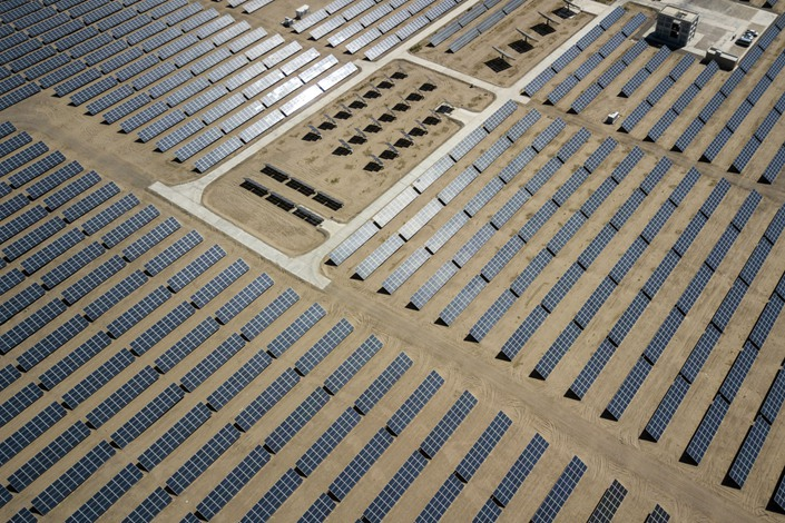Photovoltaic panels stand at a solar power station in Golmud, Qinghai province, on July 24, 2018. Photo: Bloomberg