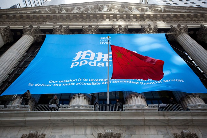The People's Republic of China flag flies in front of PPDAI Group Inc. signage displayed outside of the New York Stock Exchange on Nov. 10, 2017. Photo: Bloomberg