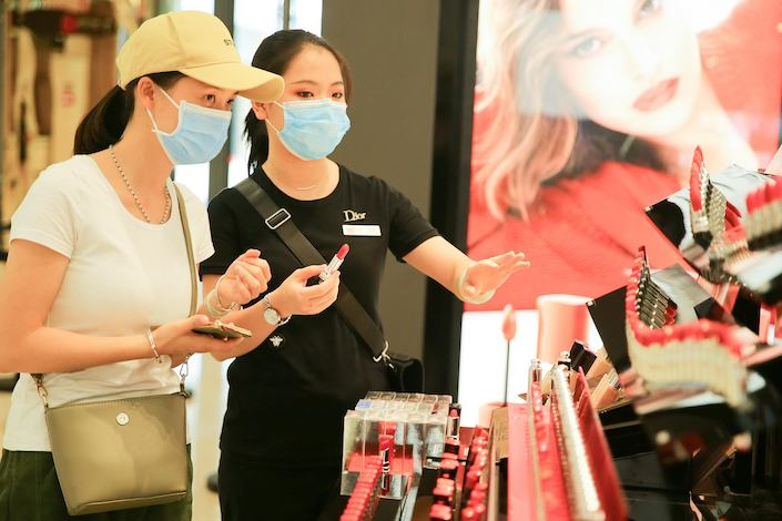 Shoppers at a cosmetics counter in the Riyue Plaza Duty Free Shop in Haikou.