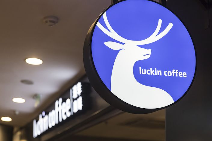 A sign for Luckin Coffee Inc. is displayed at one of the company's outlets in Shanghai