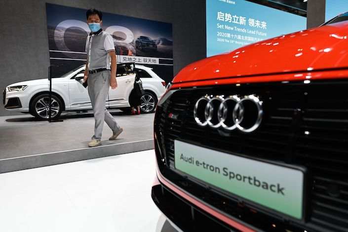 A visitor looks at an Audi e-trion car at the Beijing Auto Show in Beijing on September 27