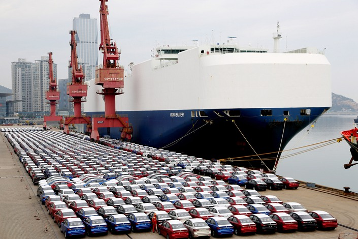 A freighter prepares Sunday to load more than 1,500 vehicles for export to Egypt at the port of Lianyungang in East China's Jiangsu Province.