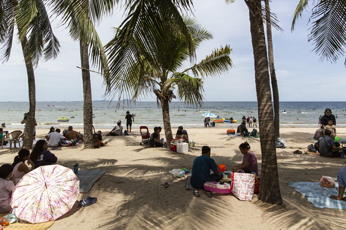 Visitors relax on Bangsaen Beach in Chonburi, Thailand, on  June 14. Photo: Bloomberg