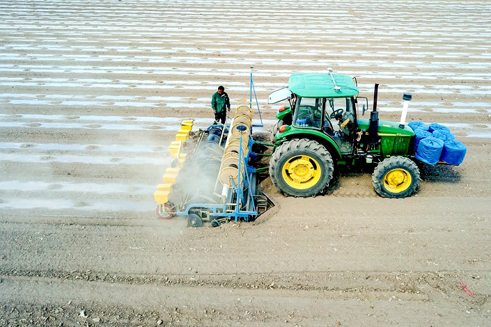 Farming machinery equipped with China's BeiDou Navigation Satellite System sows cotton in a field in western China in April 2019.