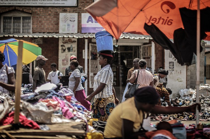 People shop in an open air market in Zambia's capital Lusaka. Photo: Bloomberg