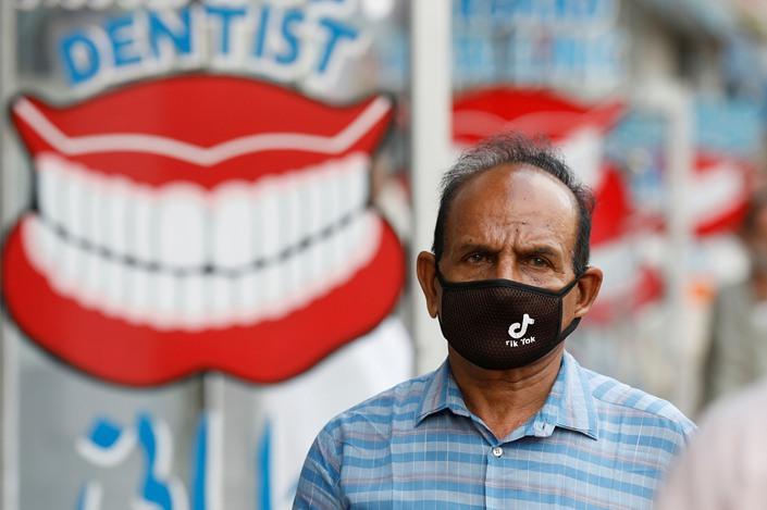 A man wears a face mask bearing the TikTok logo in Karachi, Pakistan, on July 14.