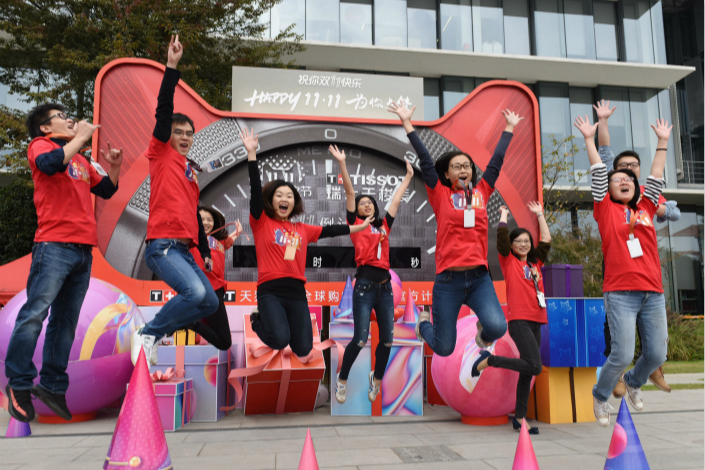 Above, workers at the Hangzhou headquarters of Alibaba's Tmall promote Double 11 in 2017. Photo: Visual China