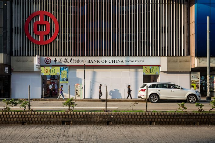 Pedestrians walk past a Bank of China Ltd. branch in the Causeway Bay district of Hong Kong on Oct. 27, 2019. Photo: Bloomberg
