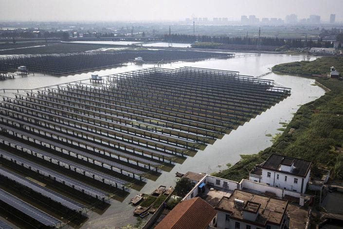 Photovoltaic panels stand at a solar farm operated by China Energy Conservation and Environmental Protection Group in this aerial photograph taken in the outskirts of Jiaxing, Zhejiang province,on Sept. 7, 2018. Photo: Bloomberg