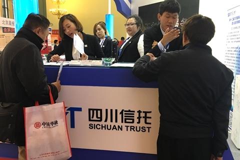 四川信托审计报告存分歧 宏信证券股权转让受限