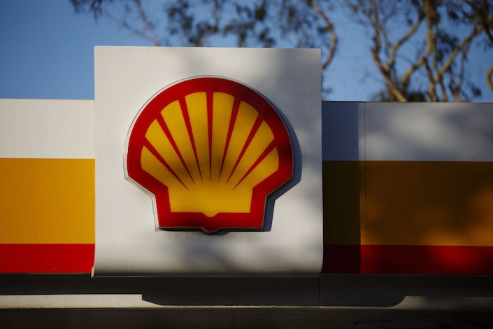 Signage is displayed outside a Royal Dutch Shell Plc gas station in Torrance