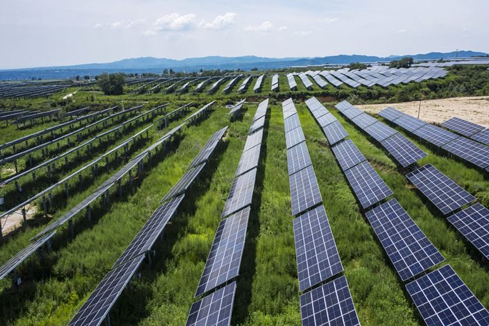 Photovoltaic modules stand at a solar power plant co-owned by Longi Green Energy in Tongchuan, Shaanxi province on July 20. Photo: Bloomberg
