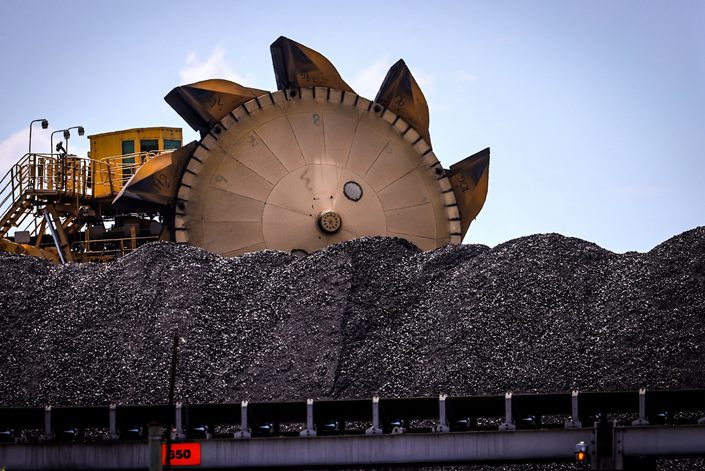 A bucket-wheel reclaimer stands next to a pile of coal at the Port of Newcastle in Newcastle, New South Wales, Australia, on Oct. 12. Photo: Bloomberg