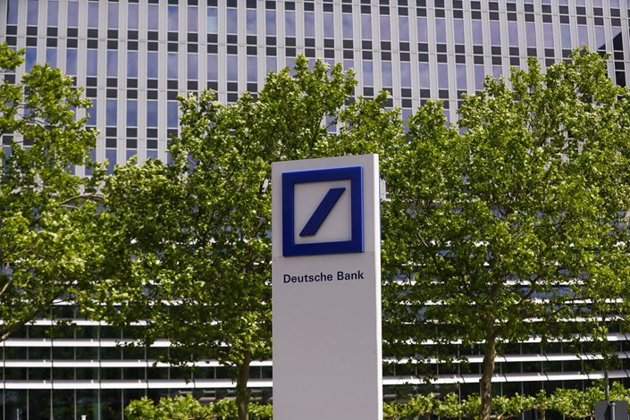 A Deutsche Bank AG logo sits on display outside the bank's offices in Eschborn