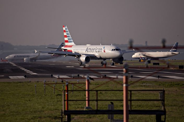 An American Airlines Group Inc. Airbus A319 plane taxis after landing at Reagan National Airport in Arlington, Virginia, U.S., on April 6. Photo: Bloomberg