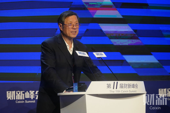 Xu Xianchun speaks at the 11th Caixin Summit in Beijing Nov. 13.