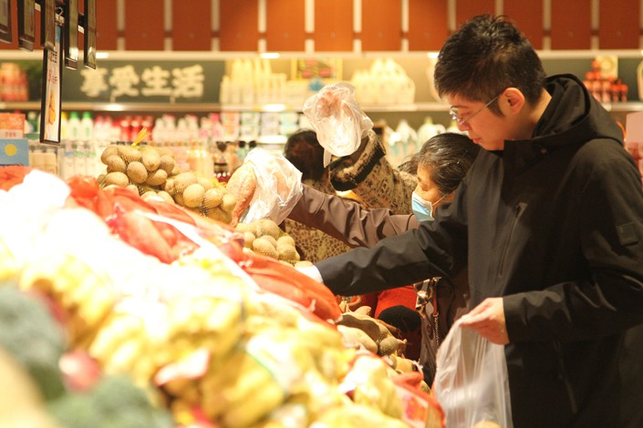 Residents shop at a supermarket in Xuchang, Henan province, on Oct. 31.