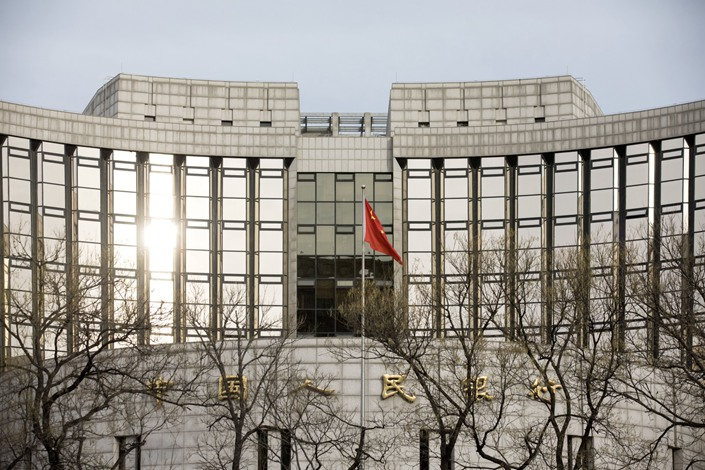 A Chinese flag flies in front of PBOC headquarters in Beijing in January 2019.  Photo: Bloomberg