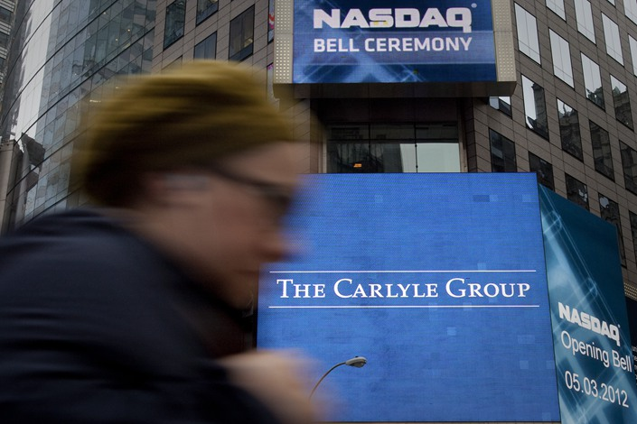 purchases asian media outlets group Carlyle