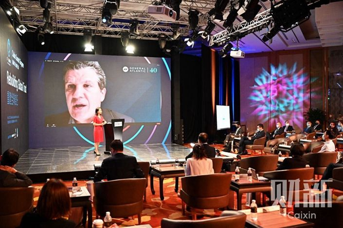 Bill Ford, CEO of General Atlantic, addresses the 11th Caixin Summit via video link. Photo: Caixin Conferences