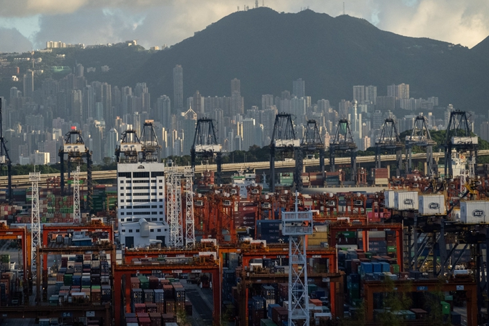 Shipping containers and gantry cranes at the Kwai Tsing Container Terminal in Hong Kong on Sept. 16. Photo: Bloomberg