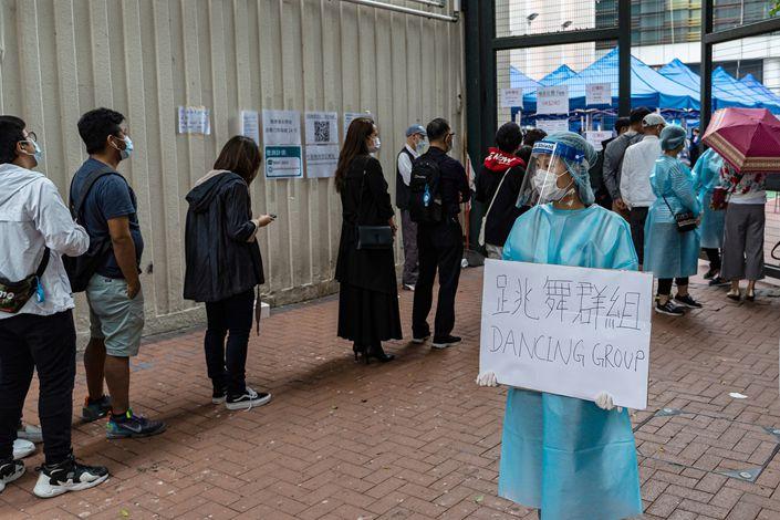 People queue for coronavirus testing in Hong Kong on Nov. 23.