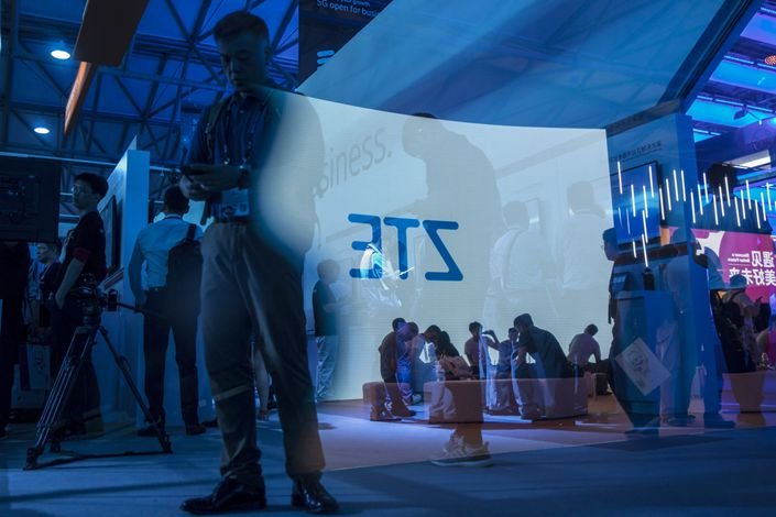 The ZTE Corp. logo projected on a screen is reflected on a pane of glass at the Ericsson AB booth at the Mobile World Congress Shanghai on June 28, 2018. Photo: Bloomberg