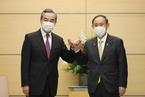 王毅与日本首相菅义伟会谈 双方商定协作办好奥运